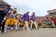 Sep 7, 2013; Baton Rouge, LA, USA; LSU Tigers head coach Les Miles and the Tigers make their way onto the field prior to kickoff against the UAB Blazers at Tiger Stadium. LSU defeated UAB 56-17. Mandatory Credit: Crystal LoGiudice-USA TODAY Sports