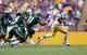 Sep 7, 2013; Baton Rouge, LA, USA; LSU Tigers wide receiver Travin Dural (83) carries the ball in front of UAB Blazers cornerback Kelton Brackett (21) and cornerback Cortez Webb (14) in the first quarter at Tiger Stadium. LSU defeated UAB 56-17. Mandatory Credit: Crystal LoGiudice-USA TODAY Sports