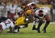 September 7, 2013; Los Angeles, CA, USA; Southern California Trojans running back Tre Madden (23) is brought down by the Washington State Cougars defense during the first half at the Los Angeles Memorial Coliseum. Mandatory Credit: Gary A. Vasquez-USA TODAY Sports