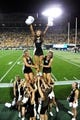 Sep 7, 2013; Boulder, CO, USA; Colorado Buffaloes cheerleaders perform in the third quarter against the Central Arkansas Bears at Folsom Field. The Buffaloes defeated the Bears 38-24. Mandatory Credit: Ron Chenoy-USA TODAY Sports