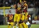 September 7, 2013; Los Angeles, CA, USA; Southern California Trojans linebacker Morgan Breslin (91) is congratulated by linebacker Hayes Pullard (10) after sacking Washington State Cougars quarterback Connor Halliday (12) during the second half at the Los Angeles Memorial Coliseum. Mandatory Credit: Gary A. Vasquez-USA TODAY Sports