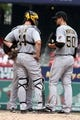 Sep 8, 2013; St. Louis, MO, USA;  Pittsburgh Pirates starting pitcher Charlie Morton (50) talks with catcher John Buck (14) prior to leaving the game in the second inning of a baseball game against the St. Louis Cardinals at Busch Stadium. Mandatory Credit: Scott Kane-USA TODAY Sports