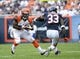 Sep 8, 2013; Chicago, IL, USA;  Cincinnati Bengals running back Giovani Bernard (25) rushes the ball against Chicago Bears cornerback Charles Tillman (33) during the fourth quarter at Soldier Field. Chicago defeats Cincinnati 24-21. Mandatory Credit: Mike DiNovo-USA TODAY Sports