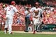 Sep 8, 2013; St. Louis, MO, USA;  St. Louis Cardinals second baseman Matt Carpenter (13) is congratulated by left fielder Matt Holliday (7) after scoring a run in the second inning against the Pittsburgh Pirates at Busch Stadium. Mandatory Credit: Scott Kane-USA TODAY Sports