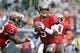 Sep 8, 2013; East Rutherford, NJ, USA; Tampa Bay Buccaneers quarterback Josh Freeman (5) drops back to pass against the New York Jets during the first half at MetLife Stadium. The Jets won 18-17. Mandatory Credit: Joe Camporeale-USA TODAY Sports