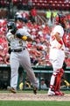 Sep 8, 2013; St. Louis, MO, USA; Pittsburgh Pirates Josh Harrison (5) scores a run in the ninth inning during a baseball game against the St. Louis Cardinals at Busch Stadium. Mandatory Credit: Scott Kane-USA TODAY Sports
