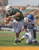 Sep 7, 2013; Waco, TX, USA; Baylor Bears quarterback Bryce Petty (14) scores a touchdown past Buffalo Bulls defensive back Witney Sherry (10) during the game at Floyd Casey Stadium. The Bears defeated the Bulls 70-13. Mandatory Credit: Jerome Miron-USA TODAY Sports