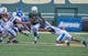 Sep 7, 2013; Waco, TX, USA; Baylor Bears running back Lache Seastrunk (25) eludes Buffalo Bulls linebacker Nick Gilbo (43) and defensive back Adam Redden (29) during the game at Floyd Casey Stadium. The Bears defeated the Bulls 70-13. Mandatory Credit: Jerome Miron-USA TODAY Sports