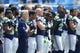 Sep 8, 2013; Charlotte, NC, USA; Seattle Seahawks head coach Pete Carroll (on left side in solid blue shirt) stands with the players during the national anthem before the game. The Seahawks defeated the Panthers 12-7 at Bank of America Stadium. Mandatory Credit: Bob Donnan-USA TODAY Sports