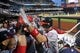 Sep 9, 2013; New York, NY, USA; Washington Nationals third baseman Ryan Zimmerman (11) gets high fives in the dugout after hitting a solo home run against the New York Mets during the first inning of a game at Citi Field. Mandatory Credit: Brad Penner-USA TODAY Sports