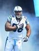 Sep 8, 2013; Charlotte, NC, USA; Carolina Panthers defensive tackle Star Lotulelei (98) runs on to the field before the game at Bank of America Stadium. Mandatory Credit: Bob Donnan-USA TODAY Sports