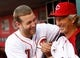 Sep 9, 2013; Cincinnati, OH, USA; Cincinnati Reds third baseman Todd Frazier (21) and bench coach Chris Speier (35) joke around prior to the game against the Chicago Cubs at Great American Ball Park. Mandatory Credit: Frank Victores-USA TODAY Sports
