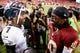 Sep 9, 2013; Landover, MD, USA; Philadelphia Eagles quarterback Michael Vick (7) and Washington Redskins quarterback Robert Griffin III (10) talk on the field after their game at FedEx Field. The Philadelphia Eagles won 33-27. Mandatory Credit: Geoff Burke-USA TODAY Sports