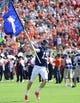 Sep 7, 2013; Charlottesville, VA, USA; Virginia Cavaliers quarterback Matt Johns (15) carries the Virginia flag as he runs on to the field before the game at Scott Stadium. Mandatory Credit: Bob Donnan-USA TODAY Sports