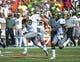Sep 7, 2013; Charlottesville, VA, USA; Oregon Ducks quarterback Marcus Mariota (8) runs for a touchdown early in the first quarter as  running back De'Anthony Thomas (6) runs beside him at Scott Stadium. Mandatory Credit: Bob Donnan-USA TODAY Sports