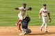 Sep 8, 2013; Philadelphia, PA, USA; Philadelphia Phillies shortstop Jimmy Rollins (11) throws to first base to complete the double play after forcing Atlanta Braves second baseman Dan Uggla (26) at second base during the eighth inning at Citizens Bank Park. The Phillies defeated the Braves 3-2. Mandatory Credit: Howard Smith-USA TODAY Sports