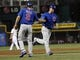 Sep 10, 2013; Cincinnati, OH, USA; Chicago Cubs third baseman Donnie Murphy (8) is congratulated by third base coach David Bell (3) after hitting a home run during the third inning against the Cincinnati Reds at Great American Ball Park. Mandatory Credit: Frank Victores-USA TODAY Sports