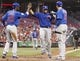 Sep 10, 2013; Cincinnati, OH, USA; Chicago Cubs catcher Welington Castillo (53) is congratulated by left fielder Junior Lake (21) and center fielder Ryan Sweeney (6) after hitting a home run during the second inning against the Cincinnati Reds at Great American Ball Park. Mandatory Credit: Frank Victores-USA TODAY Sports