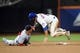 Sep 10, 2013; New York, NY, USA; Washington Nationals shortstop Ian Desmond (20) tags out New York Mets center fielder Matt den Dekker (6) during a steal attempt during the sixth inning at Citi Field. Mandatory Credit: Joe Camporeale-USA TODAY Sports