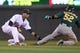 Sep 10, 2013; Minneapolis, MN, USA; Minnesota Twins shortstop Pedro Florimon (25) tags out Oakland Athletics outfielder Yoenis Cespedes (52) during the sixth inning at Target Field. Mandatory Credit: Brace Hemmelgarn-USA TODAY Sports