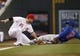 Sep 10, 2013; Cincinnati, OH, USA; Chicago Cubs left fielder Junior Lake (21) steals third base under Cincinnati Reds third baseman Todd Frazier (21) during the second inning at Great American Ball Park. Mandatory Credit: Frank Victores-USA TODAY Sports