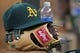 Sep 10, 2013; Minneapolis, MN, USA; An Oakland Athletics hat and glove rest on the steps of the dugout during the game against the Minnesota Twins at Target Field. The Twins won 4-3. Mandatory Credit: Brace Hemmelgarn-USA TODAY Sports
