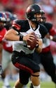 Sep 7, 2013; Oxford, MS, USA; Southeast Missouri State Redhawks quarterback Scott Lathrop (17) drops back for a pass during the game against the Mississippi Rebels at Vaught-Hemingway Stadium. Mississippi Rebels defeated the Southeast Missouri State Redhawks 31-13.  Mandatory Credit: Spruce Derden-USA TODAY Sports