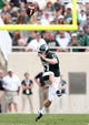 Sep 7, 2013; East Lansing, MI, USA; Michigan State Spartans kicker Kevin Muma (17) kicks the ball off to start the second half of a game between the Michigan State Spartans and the South Florida Bulls at Spartan Stadium. MSU won 21-6. Mandatory Credit: Mike Carter-USA TODAY Sports