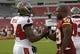 Aug 29, 2013; Tampa, FL, USA; Tampa Bay Buccaneers cornerback Darrelle Revis (24) and Washington Redskins inside linebacker London Fletcher (59) talk prior to the game at Raymond James Stadium. Mandatory Credit: Kim Klement-USA TODAY Sports