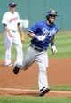 Sep 11, 2013; Cleveland, OH, USA; Kansas City Royals left fielder Alex Gordon (4) rounds third base after hitting a home run during the first inning against the Cleveland Indians at Progressive Field. Mandatory Credit: Ken Blaze-USA TODAY Sports