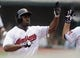 Sep 11, 2013; Cleveland, OH, USA; Cleveland Indians center fielder Michael Bourn (24) is congratulated by Cleveland Indians designated hittter Jason Kubel (right) after scoring in the first inning against the Kansas City Royals at Progressive Field. Mandatory Credit: Ken Blaze-USA TODAY Sports
