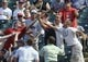 Sep 11, 2013; Cleveland, OH, USA; Fans fight for a foul ball hit by Cleveland Indians catcher Yan Gomes (not pictured) during the seventh inning against the Kansas City Royals at Progressive Field. Mandatory Credit: Ken Blaze-USA TODAY Sports