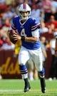 Aug 24, 2013; Landover, MD, USA; Buffalo Bills quarterback Kevin Kolb (4) rolls out during the first half against the Washington Redskins at FedEX Field. Mandatory Credit: Brad Mills-USA TODAY Sports