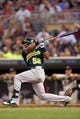 Sep 11, 2013; Minneapolis, MN, USA; Oakland Athletics left fielder Yoenis Cespedes (52) hits a RBI double in the second inning against the Minnesota Twins at Target Field. Mandatory Credit: Jesse Johnson-USA TODAY Sports