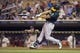 Sep 11, 2013; Minneapolis, MN, USA; Oakland Athletics designated hitter Seth Smith (15) hits a double in the fourth inning against the Minnesota Twins at Target Field. Mandatory Credit: Jesse Johnson-USA TODAY Sports