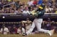 Sep 11, 2013; Minneapolis, MN, USA; Oakland Athletics shortstop Jed Lowrie (8) hits a RBI double in the fourth inning against the Minnesota Twins at Target Field. Mandatory Credit: Jesse Johnson-USA TODAY Sports