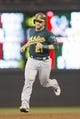 Sep 11, 2013; Minneapolis, MN, USA; Oakland Athletics catcher Stephen Vogt (21) rounds second base after hitting a two run home run in the fourth inning against the Minnesota Twins at Target Field. Mandatory Credit: Jesse Johnson-USA TODAY Sports