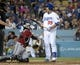 Sep 11, 2013; Los Angeles, CA, USA; Los Angeles Dodgers pitcher Hyun-Jin Ryu (99) reacts after being called for a strike with the bases loaded in the second inning as Arizona Diamondbacks catcher Tuffy Gosewisch (54) watches at Dodger Stadium. Mandatory Credit: Kirby Lee-USA TODAY Sports