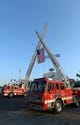 Sep 11, 2013; Los Angeles, CA, USA; City of Los Angeles fire department trucks hoist a United States flag in remembrance of the terrorist attacks of Sept. 11, 2001 before the MLB game between the Arizona Diamondbacks and the Los Angeles Dodgers at Dodger Stadium. Mandatory Credit: Kirby Lee-USA TODAY Sports