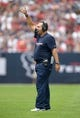 Aug 25, 2013; Houston, TX, USA; Houston Texans tight ends coach Brian Pariani gestures during the game against the New Orleans Saints at Reliant Stadium. Mandatory Credit: Kirby Lee-USA TODAY Sports