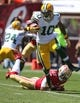 Sep 8, 2013; San Francisco, CA, USA; Green Bay Packers wide receiver Jeremy Ross (10) escapes the tackle by San Francisco 49ers defensive back C.J. Spillman (27) during the first quarter at Candlestick Park. Mandatory Credit: Kelley L Cox-USA TODAY Sports