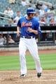 Sep 12, 2013; New York, NY, USA; New York Mets left fielder Lucas Duda (21) scores a run against the Washington Nationals at Citi Field. Mandatory Credit: Joe Camporeale-USA TODAY Sports