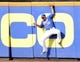 Sep 12, 2013; New York, NY, USA; New York Mets center fielder Juan Lagares (12) is unable to make a catch on a ball hit by Washington Nationals first baseman Adam LaRoche (not pictured) during the seventh inning at Citi Field. Mandatory Credit: Joe Camporeale-USA TODAY Sports