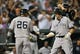 Sep 12, 2013; Baltimore, MD, USA; New York Yankees first baseman Mark Reynolds (39) is congratulated by Eduardo Nunez (26) after hitting a two-run home run in the second inning against the Baltimore Orioles at Oriole Park at Camden Yards. Mandatory Credit: Joy R. Absalon-USA TODAY Sports