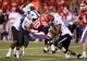 Sep 12, 2013; Ruston, LA, USA; Louisiana Tech Bulldogs running back Kenneth Dixon (28) is tackled by Tulane Green Wave defenders Royce LaFrance (48),  Nico Marley (20) and Jeremy Peeples (90) in the third quarter at Joe Aillet Stadium. Tulane won, 24-15. Mandatory Credit: Chuck Cook-USA TODAY Sports