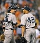 Sep 12, 2013; Baltimore, MD, USA; New York Yankees catcher Chris Stewart (19) congratulates pitcher Mariano Rivera (42) after a game against the Baltimore Orioles at Oriole Park at Camden Yards. The Yankees defeated the Orioles 6-5. Mandatory Credit: Joy R. Absalon-USA TODAY Sports