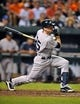 Sep 12, 2013; Baltimore, MD, USA; New York Yankees shortstop Brendan Ryan (35) singles in the ninth inning against the Baltimore Orioles at Oriole Park at Camden Yards. The Yankees defeated the Orioles 6-5. Mandatory Credit: Joy R. Absalon-USA TODAY Sports