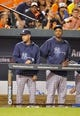 Sep 12, 2013; Baltimore, MD, USA; New York Yankees teammates Derek Jeter (left) and CC Sabathia (right) in the dugout during the ninth inning against the Baltimore Orioles at Oriole Park at Camden Yards. The Yankees defeated the Orioles 6-5. Mandatory Credit: Joy R. Absalon-USA TODAY Sports