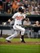 Sep 10, 2013; Baltimore, MD, USA; Baltimore Orioles right fielder Nick Markakis (21) bats in the first inning against the New York Yankees at Oriole Park at Camden Yards. The Yankees defeated the Orioles 7-5. Mandatory Credit: Joy R. Absalon-USA TODAY Sports