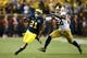 Sep 7, 2013; Ann Arbor, MI, USA; Michigan Wolverines wide receiver Jeremy Gallon (21) runs the ball by Notre Dame Fighting Irish safety Elijah Shumate (22) in first quarter at Michigan Stadium. Mandatory Credit: Rick Osentoski-USA TODAY Sports